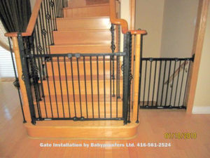 Typical black gates installed at bottom of stairs and across down stairs opening.