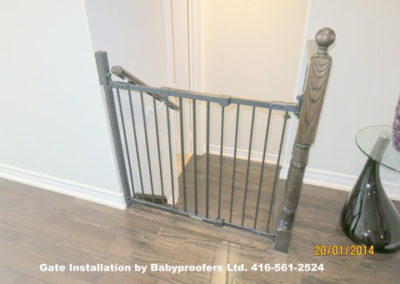 Typical baby gate installation at the top of the stairs.