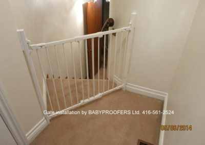 Typical baby gate installed on an angle between 2 walls.