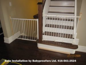 Two typical white baby gates installed side by side.