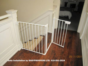 White baby gate installer with full railing on the side.